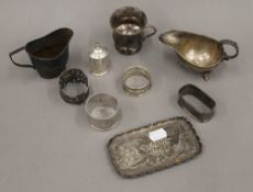 A quantity of small silver items, including a sauce boat, a cream jug, napkin rings, etc.