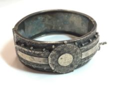 A Victorian silver hinged cuff bangle (35 grammes total weight)