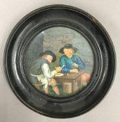 A 19th century framed miniature depicting a tavern interior scene