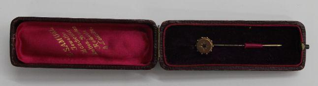 A 9 ct gold ruby set stickpin in original case