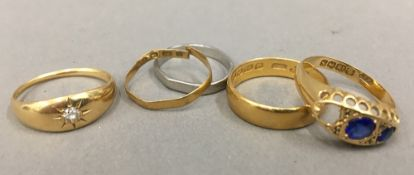 Two 22 ct gold rings (4.7 grammes), two 18 ct gold rings (5.