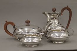 A four piece silver tea set (66 troy ounces total weight)