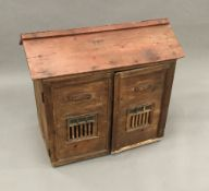 A 19th century pine animal hutch Of architectural form,