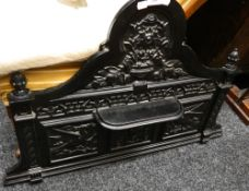 A cast iron washstand back