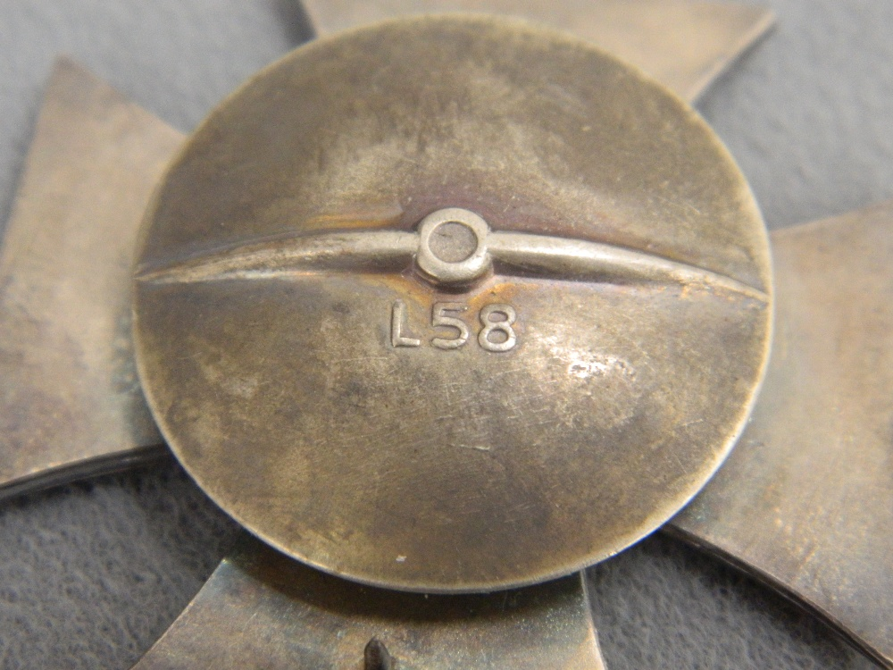 Lot 51 - A reproduction pin back 1939 Iron cross