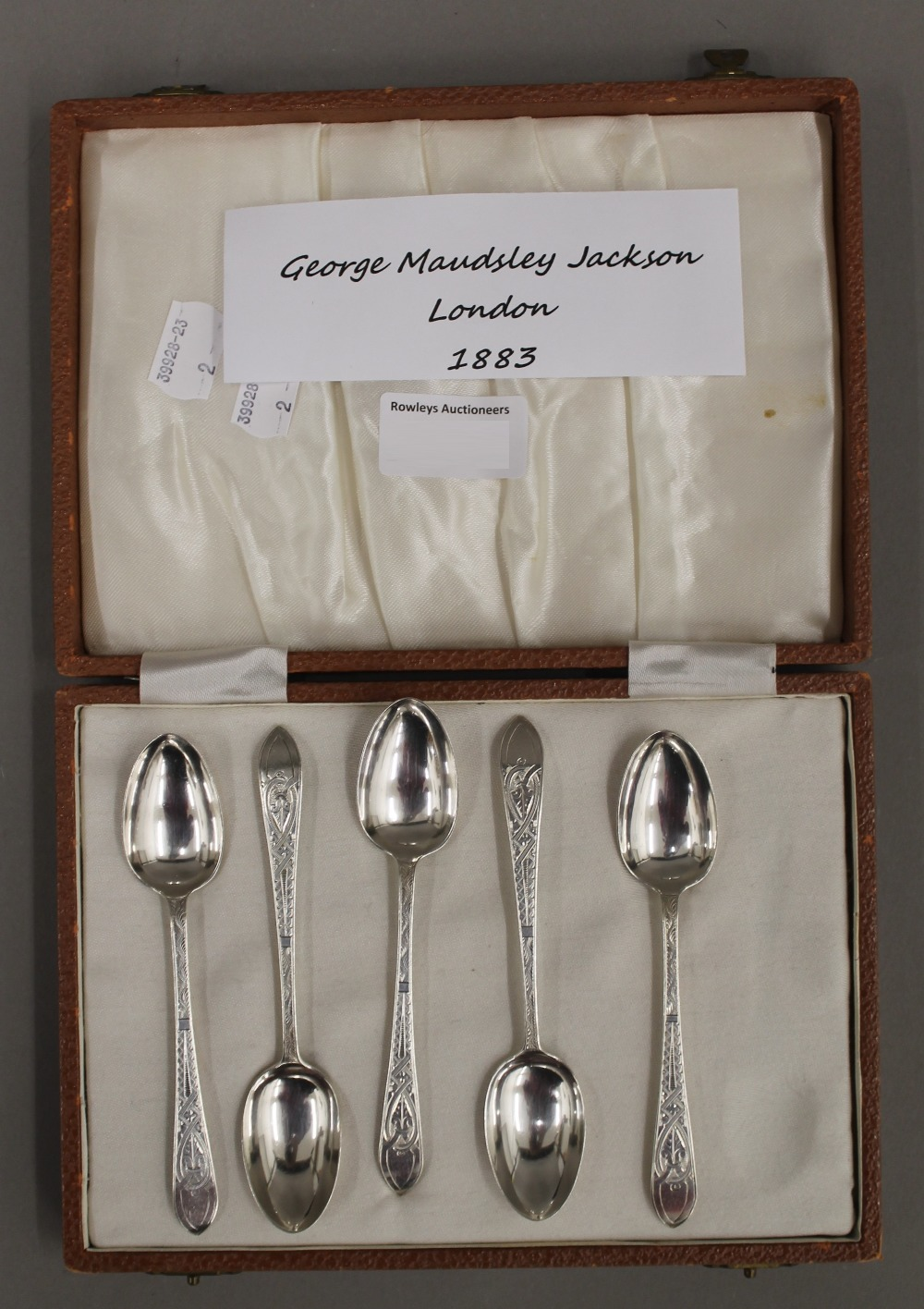 Lot 29 - A straight set of five bright cut coffee spoons by George Maudsley Jackson of London 1883,