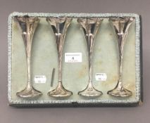 A set of four silver bud vases (12 troy ounces loaded)