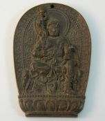 A bronze pendant decorated with a deity