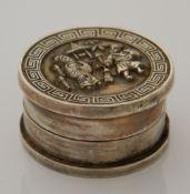 A small Chinese balm box. 2.25 cm high; 4.25 cm diameter.