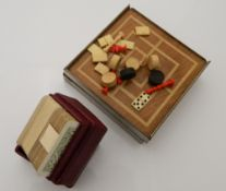 A small cased travelling chess and draughts set, etc.