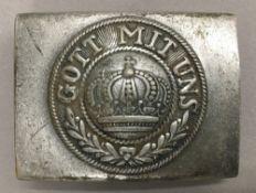 A WWI German belt buckle,