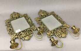 A pair of 19th century cast brass girandoles