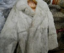 A collection of various vintage furs and fur coats
