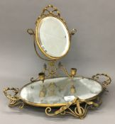 A Victorian brass and mirrored stand with twin candle sconces