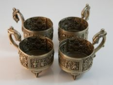 A set of four Chinese silver cup holders