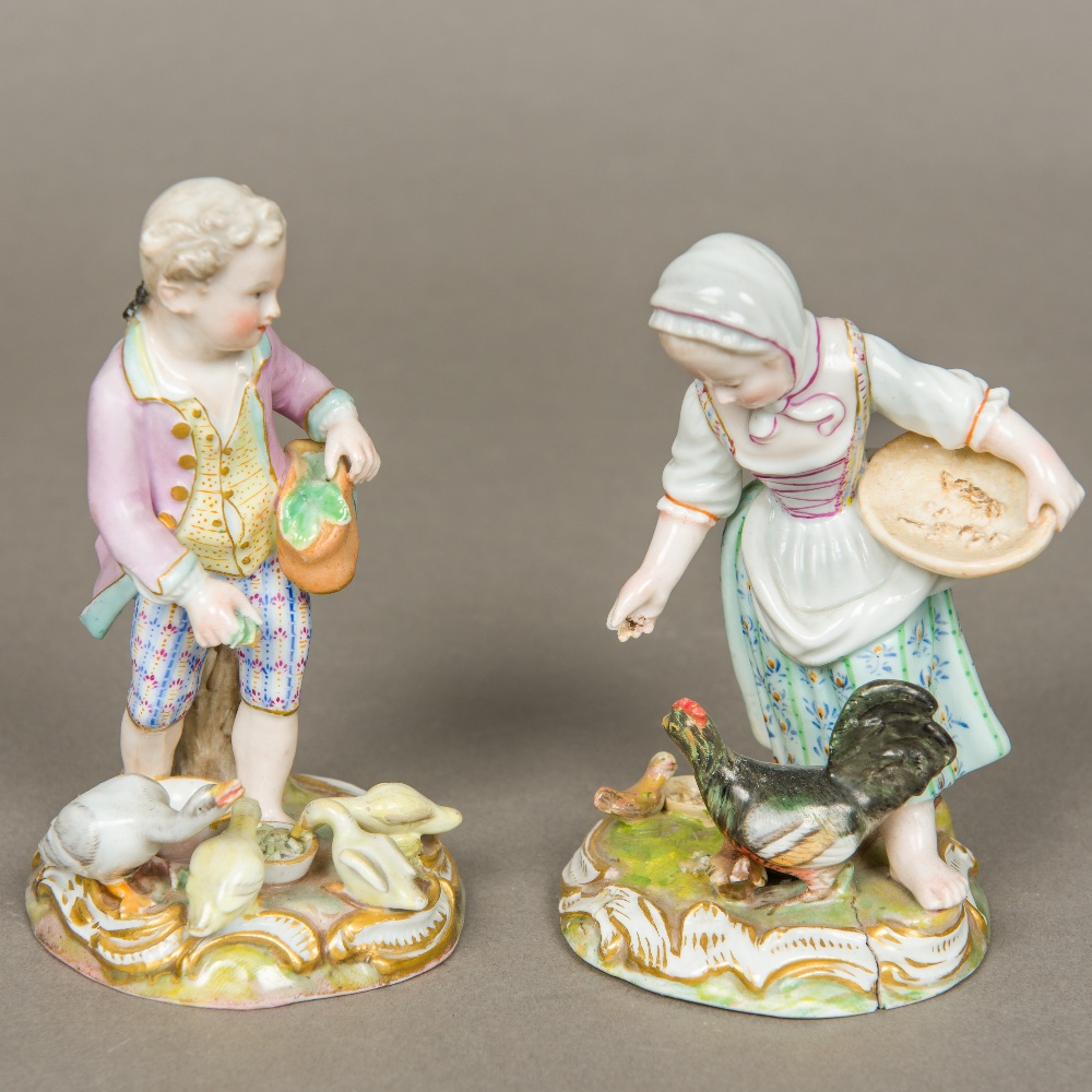 Lot 12 - A pair of 19th century Meissen porcelain figurines, one formed as a young boy feeding geese,