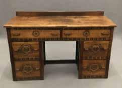 An early 20th century carved oak dressing table