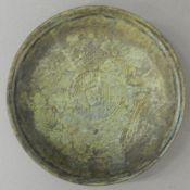 A small Chinese bronze shallow dish