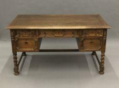 A panelled oak barley twist desk