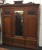 A Victorian Maple & Co walnut wardrobe