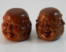 Two wooden four faced Buddha heads