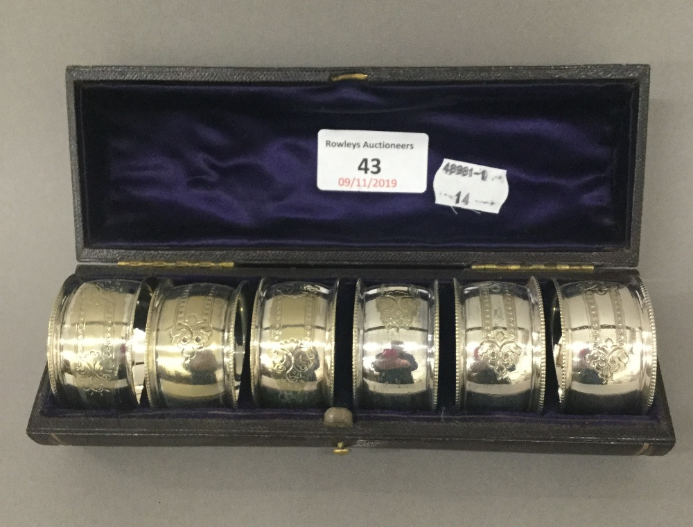 Lot 43 - A cased set of silver plated napkin rings