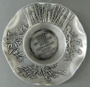 A Chinese white metal shallow dish