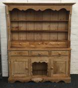 A large pine dresser. 160 cm wide, 191 cm high, 42 cm deep.