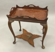 An Edwardian 18th century style mahogany silver table,