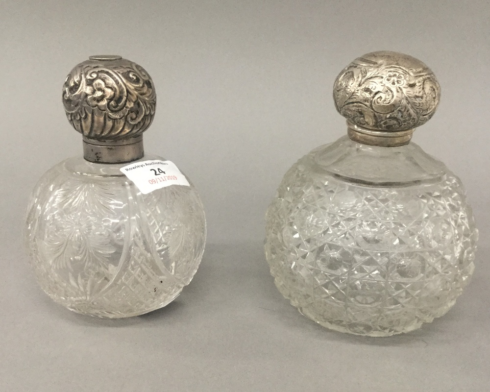 Lot 24 - Two silver topped cut glass scent bottles