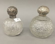 Two silver topped cut glass scent bottles