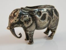 An Edwardian silver elephant form pin cushion