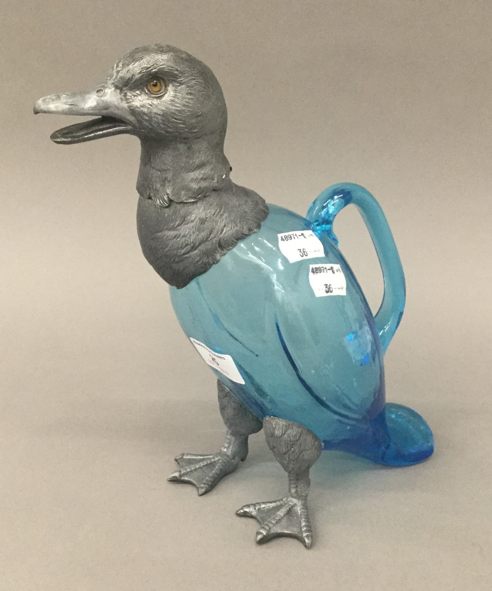 Lot 25 - A vintage French blue glass claret jug formed as a duck