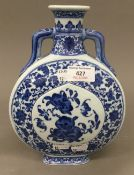 A Chinese porcelain blue and white moon flask. 9.75 cm high.