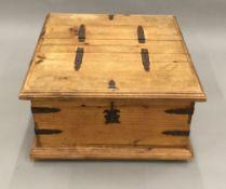 An Eastern pine twin lidded trunk