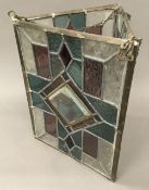 A Victorian leaded stained glass hanging lantern of triangular form