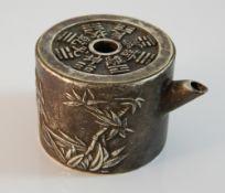 A Chinese miniature teapot. 4 cm high; 5 cm diameter.