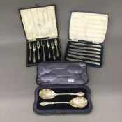 A pair of cased silver gilt serving spoons,