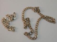 A gentleman's silver chain and bracelet (50.