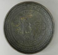 A Chinese bronze shallow dish