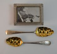 A small silver picture frame and two Georgian silver spoons