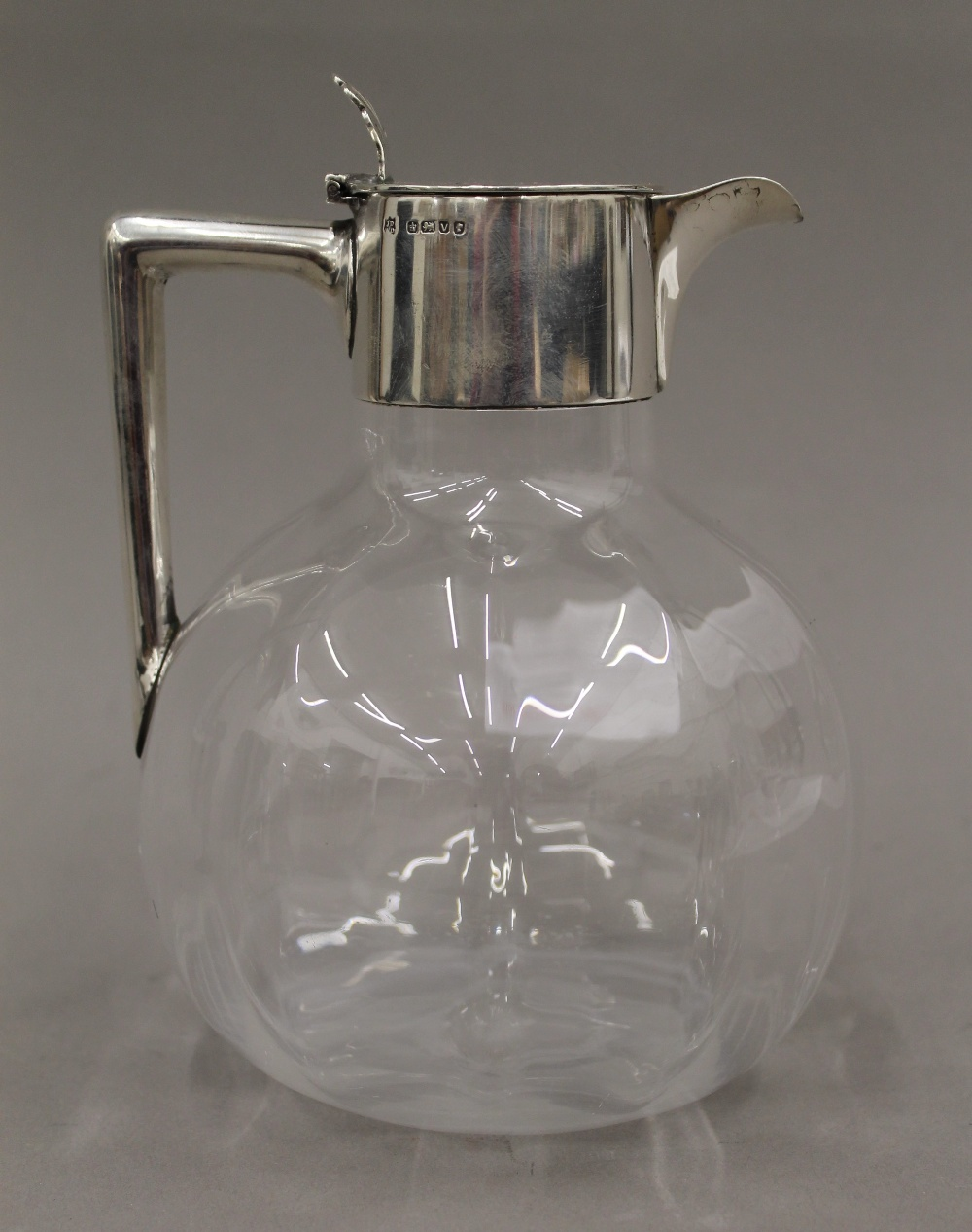 Lot 48 - A silver lidded glass claret jug,