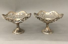 A pair of silver bon bon dishes (5.
