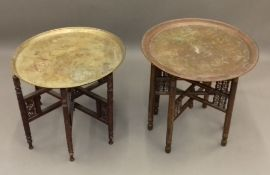 Two Eastern brass topped folding tables
