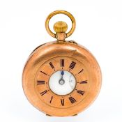 A 9 ct gold half hunter pocket watch The white enamelled dial with subsidiary seconds dial,