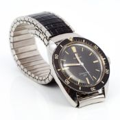 An Omega Seamaster gentleman's wristwatch The black dial with batons inscribed Omega Seamaster 120.