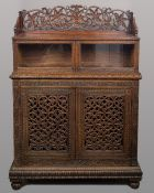 A 19th century Anglo-Indian hardwood side cabinet The top section with twin glazed doors beneath