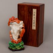 A Chinese carved two tone agate libation cup Of typical form,