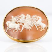 A 19th century unmarked gold mounted cameo brooch Carved with a classical scene of angels and