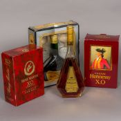 Four various bottles of Cognac Including: Hennessy XO (boxed),